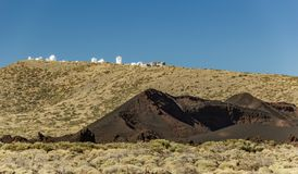 International observatory in Teide National Park. Young Volcano in the foreground. Windy day with bright blue sky and amazinc royalty free stock photos