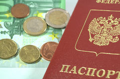 International Passport and euro coins. For journey Royalty Free Stock Photo