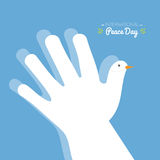 International peace day with hand making the shape of a dove on a blue sky background Royalty Free Stock Photo