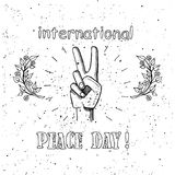 International Peace Day Poster 21 September 2017. International peace day poster on 21 September 2017 vector. Hand with raised two fingers surrounded by branches Royalty Free Stock Photography