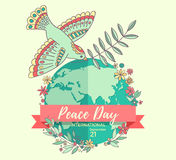 International Peace Day. 21 september. Peace dove with olive branch over the planet overgrown flowers. Hand drawn.  Stock Images