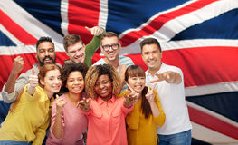 International people gesturing over british flag Royalty Free Stock Image