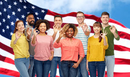 International people showing ok over american flag Stock Images