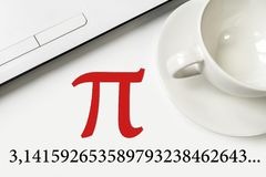 International Pi Day. On a white table a laptop and a cup. Large text and numbers stock photos