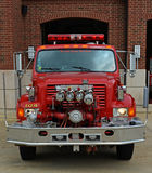 International Pumper Fire Truck Front View. Vintage International pumper fire truck front view. Shows the front mounted pumps Stock Image