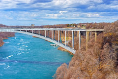 International Rainbow Bridge above Niagara River Gorge. From American side near Niagara Falls. It is an arch bridge between the United States of America and Stock Photo