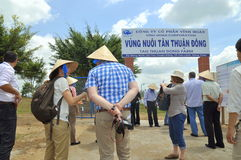 International reporters and journalists are about to enter a pangasius catfish farm in the mekong delta of Vietnam Royalty Free Stock Photos