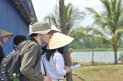 International reporters and journalists are visiting a pangasius catfish farm in the mekong delta of Vietnam Royalty Free Stock Photo