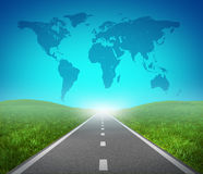 International road. Highway and global map with green grass and asphalt street representing the concept of journey to a focused international destination Royalty Free Stock Photo