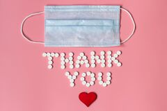 International`s nurses day, week concept, Text Thank you by tablets and red heart on pink background.
