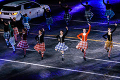 The International Scottish Highland Dance Team at the Red Square. MOSCOW, RUSSIA - AUGUST 26, 2016: Spasskaya Tower international military music festival. The Stock Images