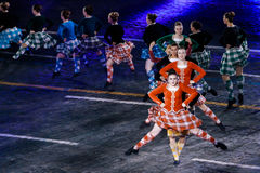 The International Scottish Highland Dance Team at the Red Square. MOSCOW, RUSSIA - AUGUST 26, 2016: Spasskaya Tower international military music festival. The Royalty Free Stock Photos