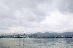 The international sea port of Novorossiysk. Port cranes and industrial objects. Marine Station. Stock Photos