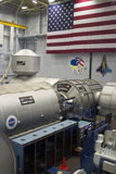 International Space Station DESTINY Mockup Sits Under an America. A mock-up of the International Space Station sits in building 9 at the NASA Johnson Space Stock Image