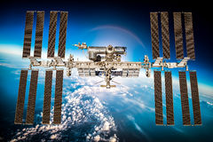 International Space Station. Over the planet earth. Elements of this image furnished by NASA Stock Image