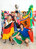 International Sports fans. Group of young sports fans from various nations all over the world, celebrating and cheering together royalty free stock photos