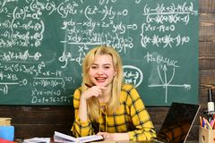 International student making individual online testing. Group of attentive adult students with teacher in classroom at. Training. Portrait of smiling bearded royalty free stock photo