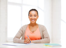 International student studying in college Stock Image