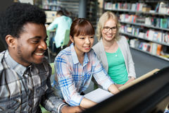 International students with computers at library Stock Images
