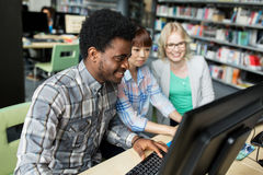 International students with computers at library Royalty Free Stock Image