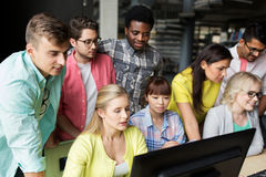 International students with computers at library Stock Image