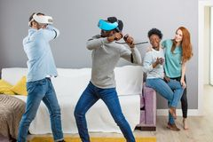 International students enjoying together with glasses of virtual reality stock photography