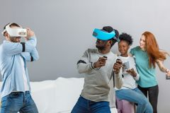 International students enjoying together with glasses of virtual reality royalty free stock image