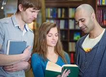 International students in a library Royalty Free Stock Photos