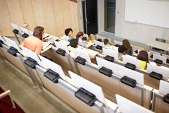 International students at university lecture hall. Education, high school, university, learning and people concept - group of international students in lecture stock photo