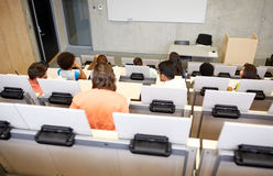 International students at university lecture hall. Education, high school, university, learning and people concept - group of international students in lecture royalty free stock photos