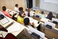 International students at university lecture hall. Education, high school, university, learning and people concept - group of international students talking in royalty free stock photos