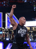 International superstar the Rock, Dwayne Johnson, holds arm in t. SANTA CLARA - MARCH 29: International superstar the Rock, Dwayne Johnson, wearing a 'just bring Stock Photos