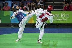 International Taekwondo Tournament in Rio - JPN vs CHN. Rio de Janeiro, Brazil, 21 February 2016: In this photo Mayu Hamada from Japan (blue) and Fenfen Chao Stock Image