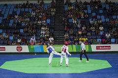 International Taekwondo Tournament in Rio - JPN vs CHN. Rio de Janeiro, Brazil, 21 February 2016: In this photo Mayu Hamada from Japan (blue) and Fenfen Chao Stock Photos