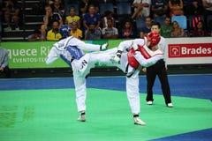 International Taekwondo Tournament in Rio - JPN vs CHN. Rio de Janeiro, Brazil, 21 February 2016: In this photo Mayu Hamada from Japan (blue) and Fenfen Chao Stock Photo