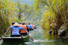 International tourists traveling on local vietnamese small boat Stock Photo