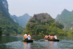 International tourists traveling on local vietnamese small boat Royalty Free Stock Photo