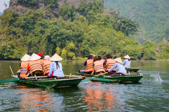 International tourists traveling on local vietnamese small boat Stock Images