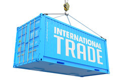 International Trade - Blue Hanging Cargo Container Stock Photos