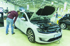 International Trade Fair RUGRIDS-ELECTRO. MOSCOW-OCTOBER 21,2015: Charging by electricity hybrid car VOLKSWAGEN Colf GTE at the International Trade Fair RUGRIDS Stock Image