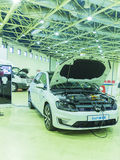 International Trade Fair RUGRIDS-ELECTRO. MOSCOW-OCTOBER 21,2015: Charging by electricity hybrid car VOLKSWAGEN Colf GTE at the International Trade Fair RUGRIDS Royalty Free Stock Photography
