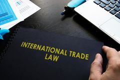 International trade law. International trade law and notebook on a table Stock Photo