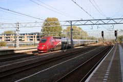 International train Thalys between Amsterdam and Paris passes station of Leiden. This is a bypass due to problems on the international high speed track royalty free stock images