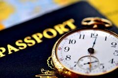 International Travel. Stock photo concept of international travel. An old pocketwatch, skeleton key, and US passport Royalty Free Stock Photo