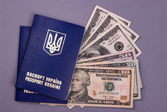 International Ukrainian passport with US dollars isolated on gray background. Royalty Free Stock Photos