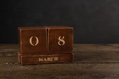 International Women's Day vintage wooden Perpetual calendar royalty free stock image