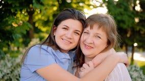 International women day greeting joy happiness. International women day. Greeting joy happiness. Smiling mother daughter embracing enjoying time stock footage