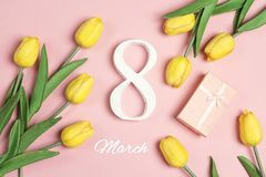 International Women`s Day background with tulip flowers on pink stock images