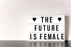 International Women`s Day - concept - `The future is female` - light box with cinema style lettering. On white background with copy Royalty Free Stock Photography