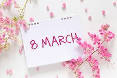 International Women`s Day. flat lay of blank calendar with the words `March 8` stock photos